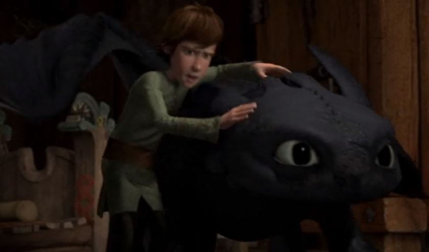 hiccup holding onto toothless