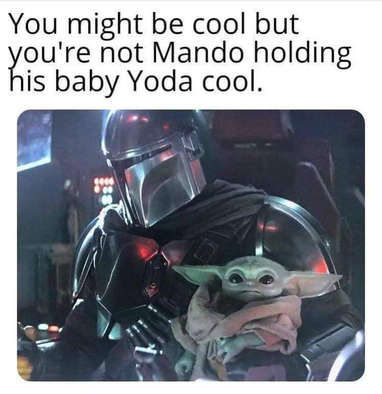 mando holding baby yoda cool